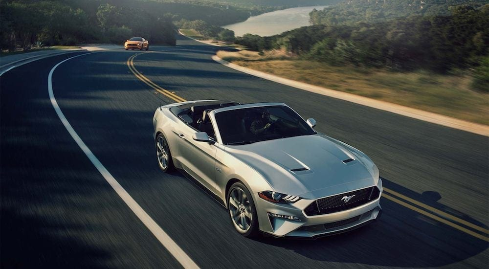 Silver 2018 Ford Mustang on highway