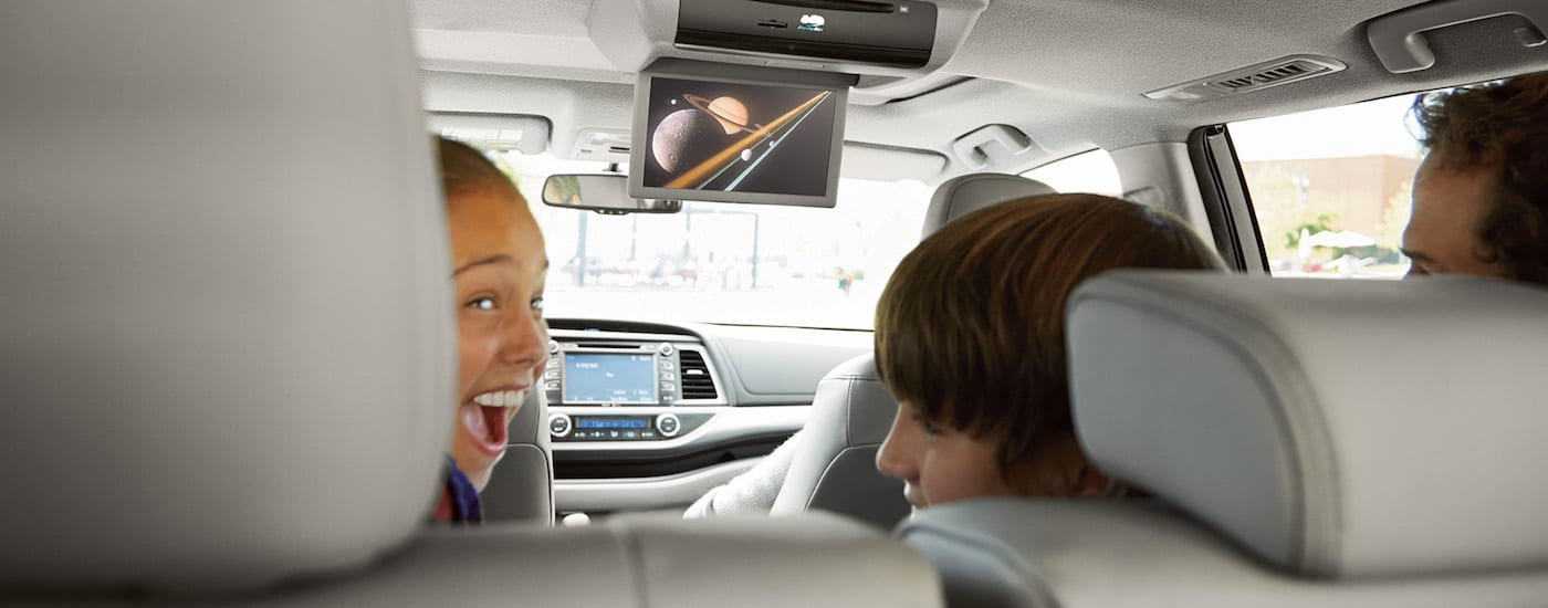 Children watching a video in the backseat of a 2018 Toyota Highlander