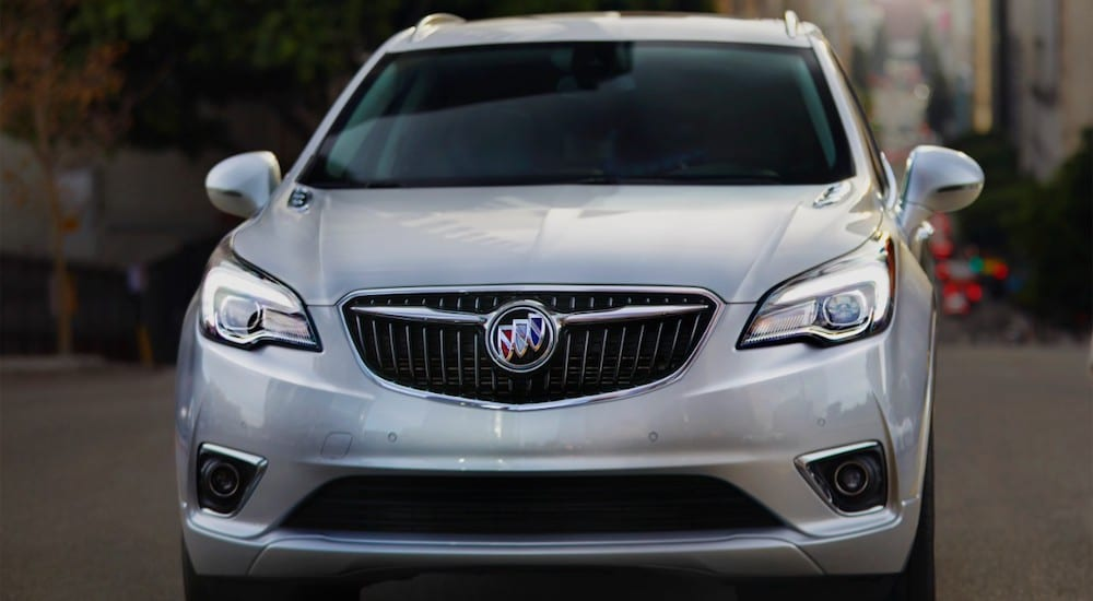 A white 2019 Buick Envision in a city