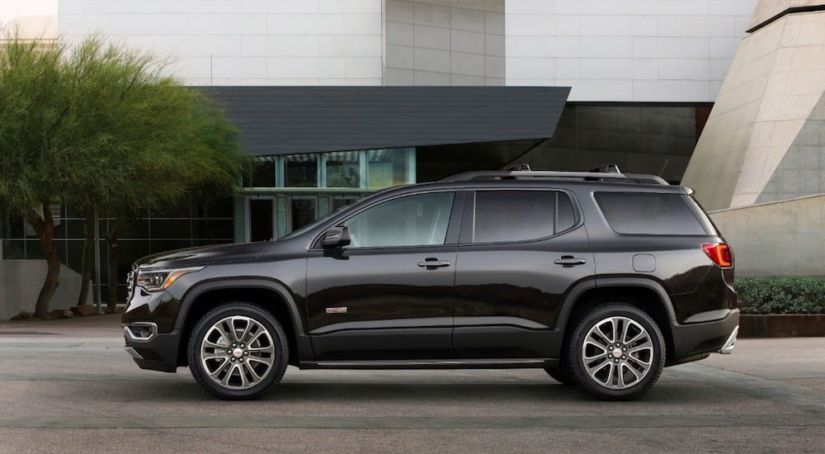 A black 2019 GMC Acadia All Terrain parked in a driveway