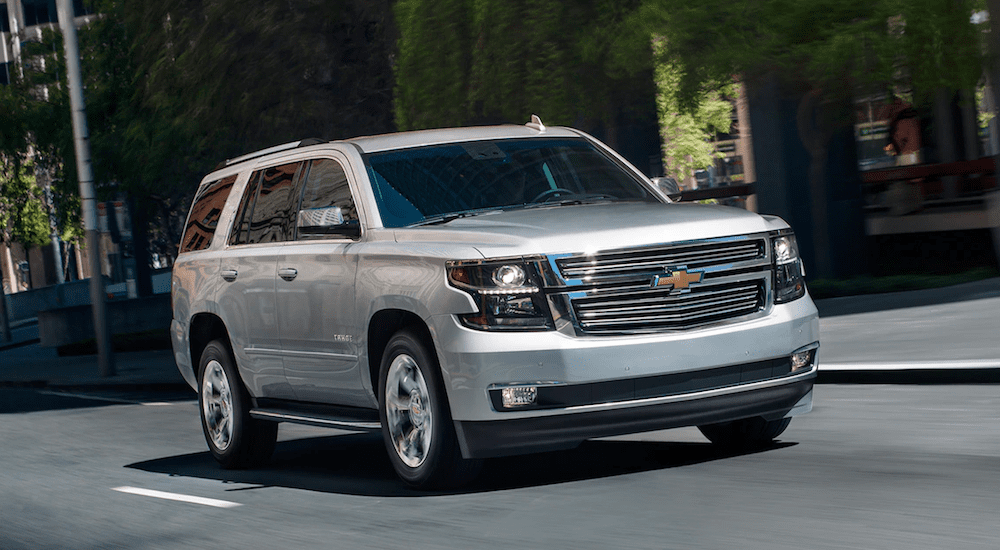 A silver 2019 Chevy Tahoe drives away victorious in the 2019 Chevy Tahoe vs 2019 Dodge Durango