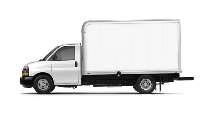A 2019 Chevy Express Cutaway with a Hicube style cargo setup is shown on a white background. Box trucks for sale can be found at a Chevy commercial dealer.