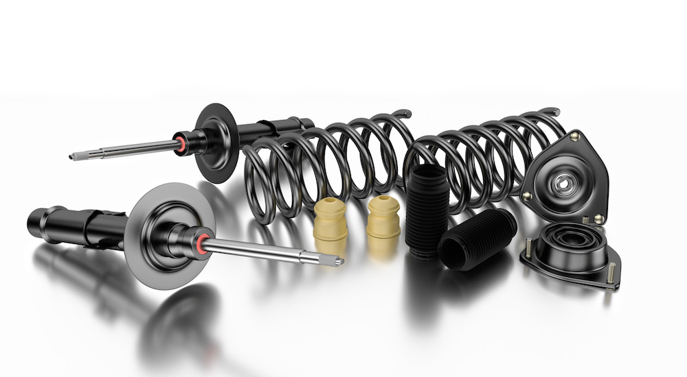 Car struts, springs, and bump stops are shown on a white background.