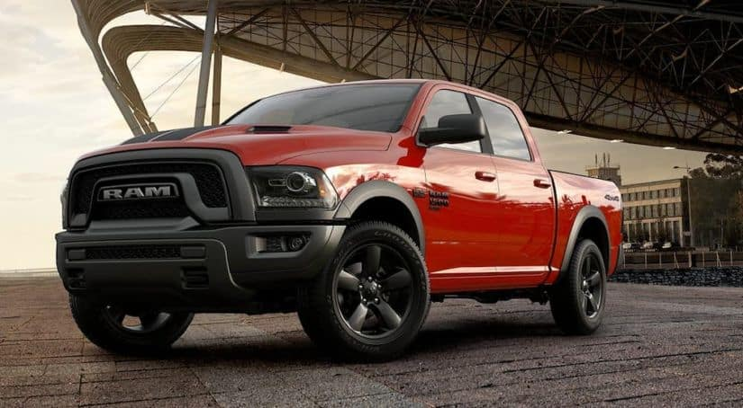 A red 2019 Ram 1500 Classic is parked with a city overhang behind it.