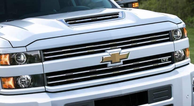A close up of a white 2017 Chevy Silverado 1500 is shown.