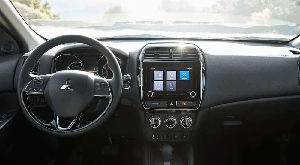 The dashboard of a 2020 Mitsubishi Outlander Sport is shown.