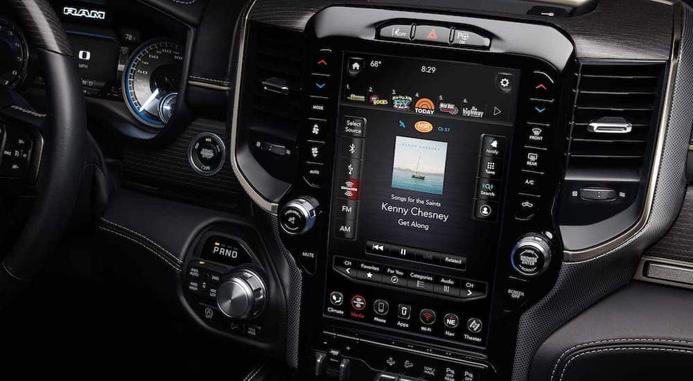 A closeup is shown of the 12-in Uconnect touchscreen available in 2500 Ram Trucks.