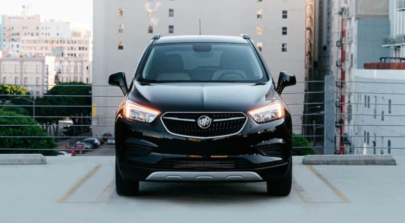 A black 2020 Buick Encore is shown from the front on a rooftop parking garage.