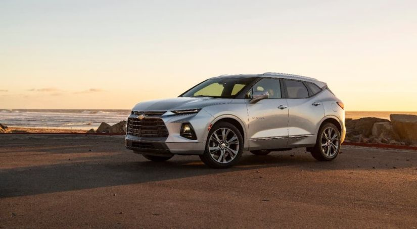 A silver 2020 Chevy Blazer is parked at a beach after winning the 2020 Chevy Blazer vs 2020 Chevy Equinox comparison.