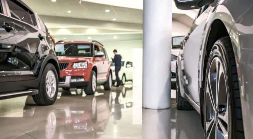 A showroom is shown that has cheap used cars for sale.