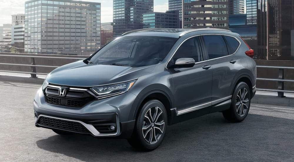 A grey 2020 Honda CR-V is parked on a rooftop parking area.
