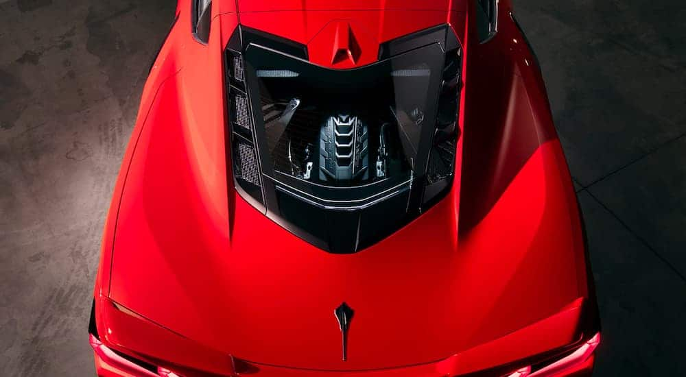 A close up is shown of the rear glass and engine from a high angle on a red 2021 Chevy Corvette.