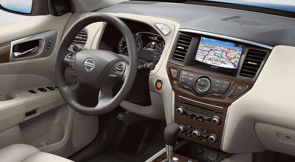 The tan and brown interior is shown on a 2021 Nissan Pathfinder