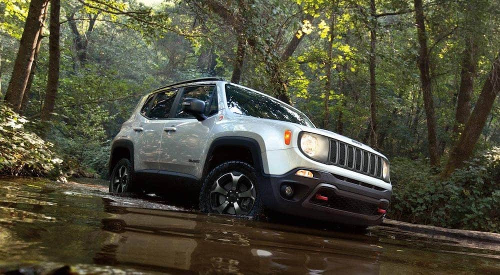A white 2020 Jeep Renegade is driving in a river after leaving a Jeep dealer in KY.