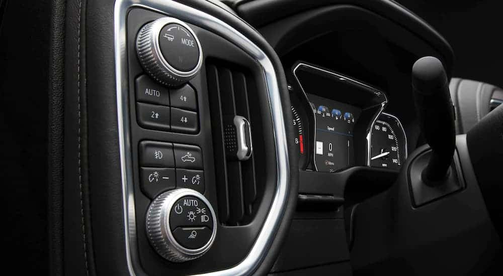 A close up shows the gauge cluster and controls in a 2021 GMC Sierra 1500.