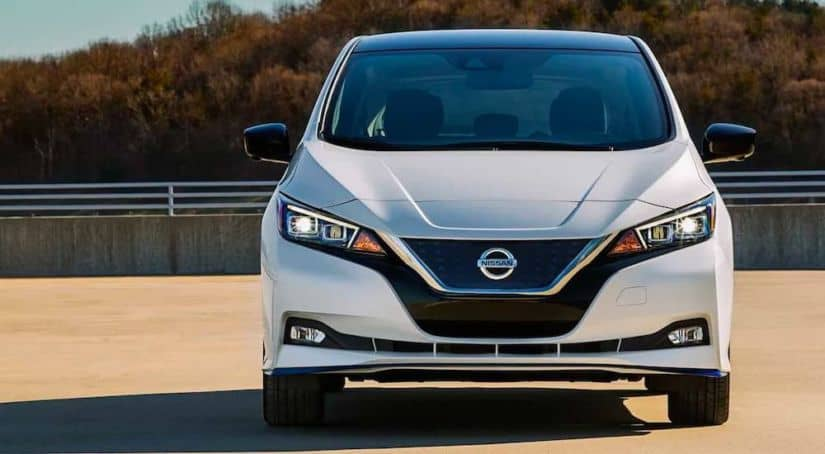 A white 2021 Nissan LEAF is shown from the front.