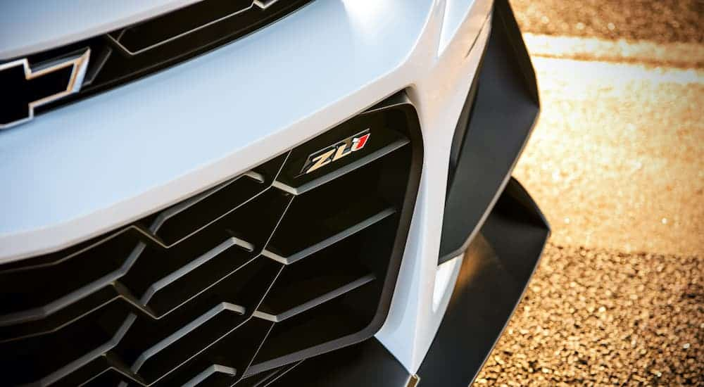 A close up shows the lower grill and ZL1 emblem on a white 2019 Chevy Camaro ZL1.