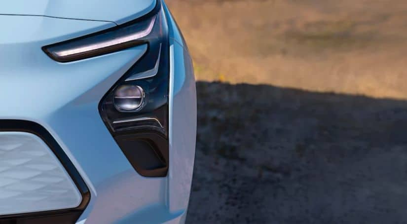 A close up shows the headlight and foglight on a 2022 Chevy Bolt EV.