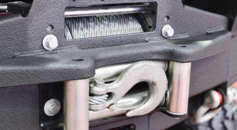 A close up shows the front winch on a 2015 used Jeep Wrangler Rubicon.