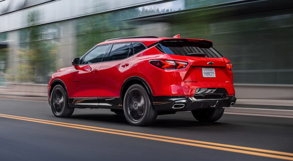 A red 2022 Chevy Blazer RS is shown driving from behind after winning a 2022 Chevy Blazer vs 2021 Nissan Murano comparison.